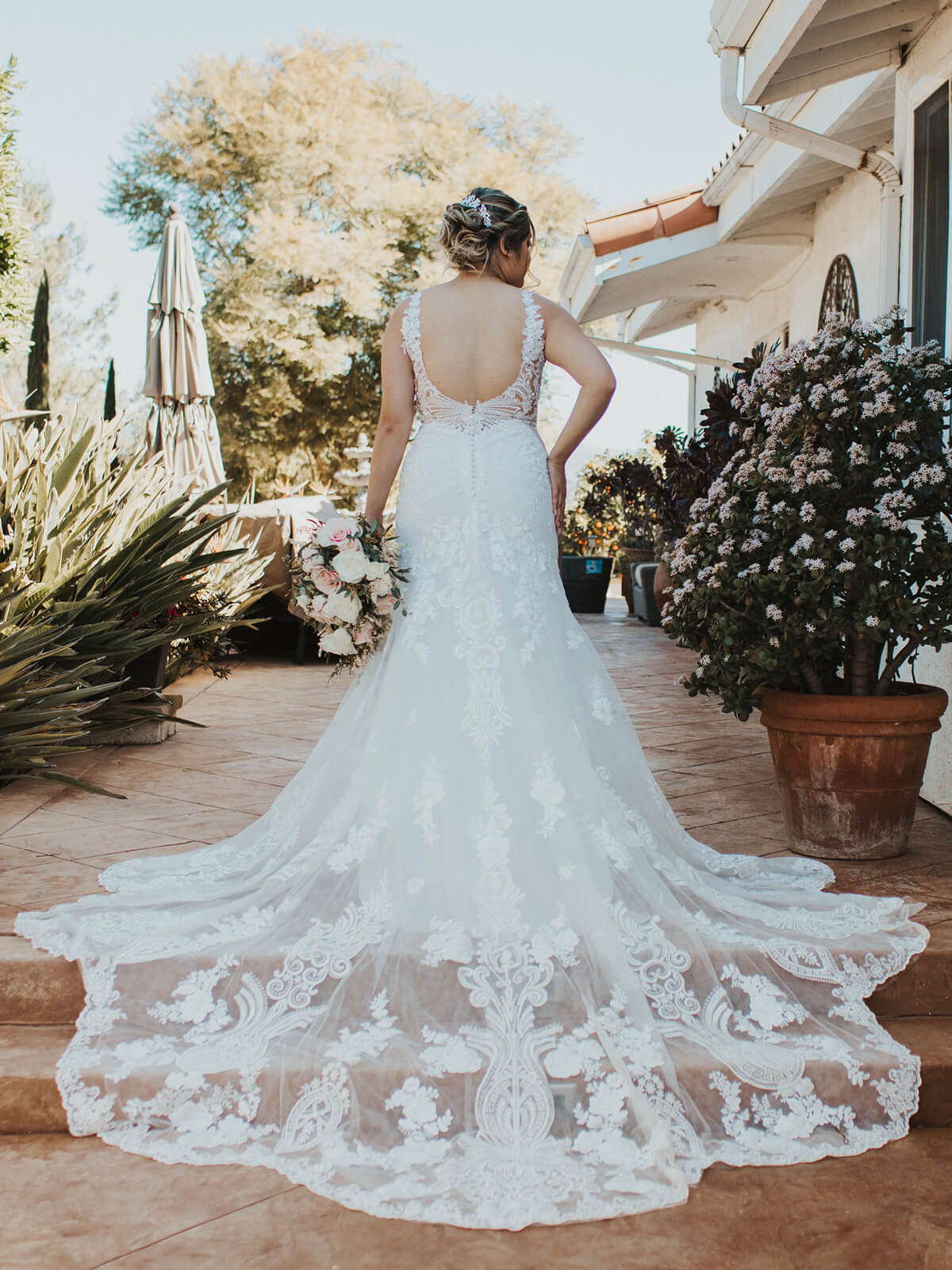 Style Willa's gorgeous lace train + Karina + this gorgeous venue = a recipe for beauty.
