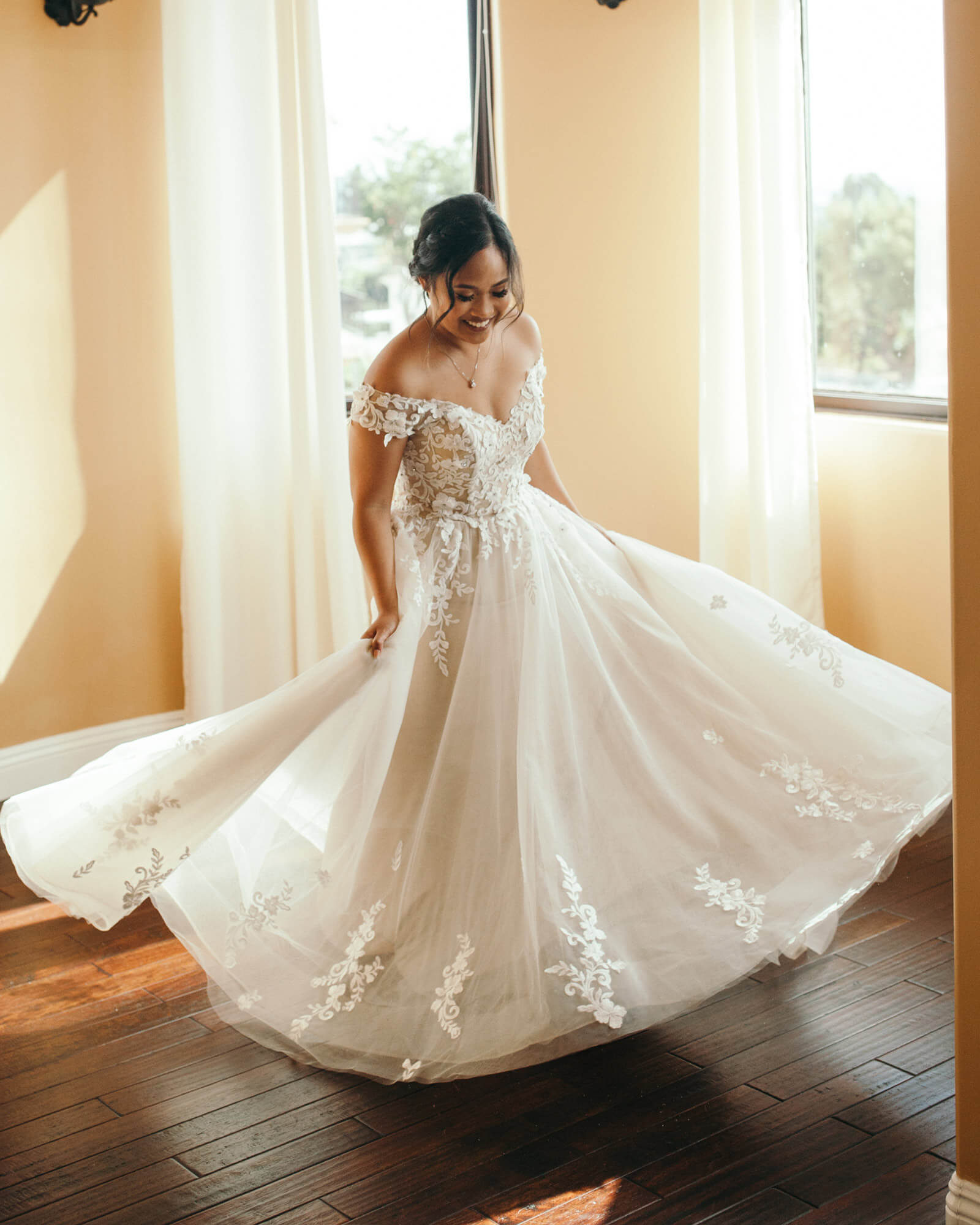 With a twirl-worthy dress this beautiful, we'd be beaming, too!