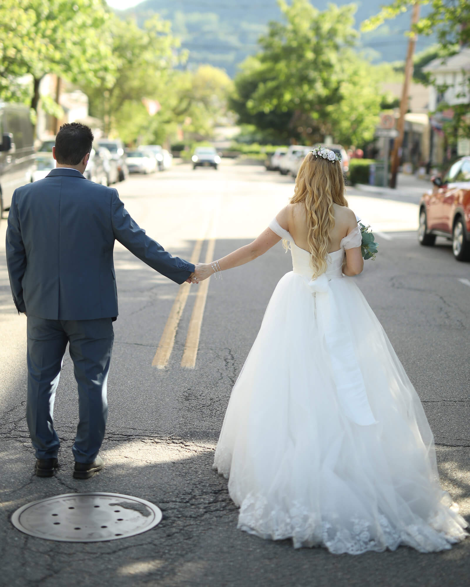 Holding hands and walk into the next chapter of your happiness together